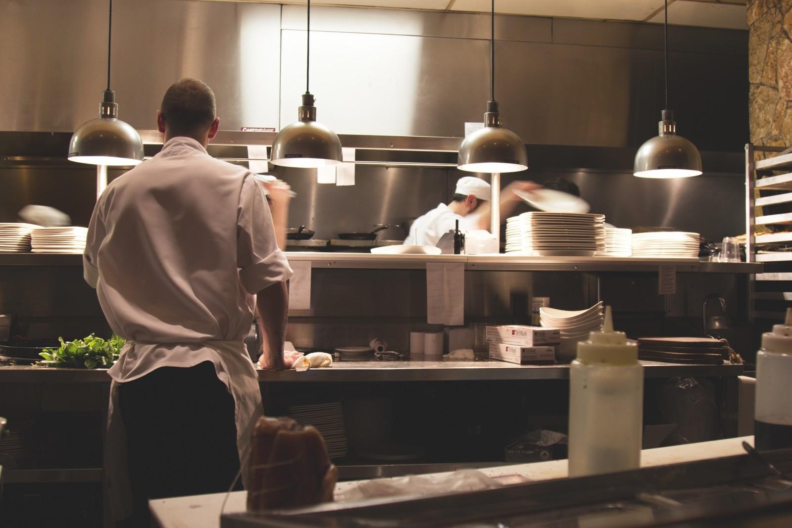 chief-preparing-food-in-restaurant-kitchen